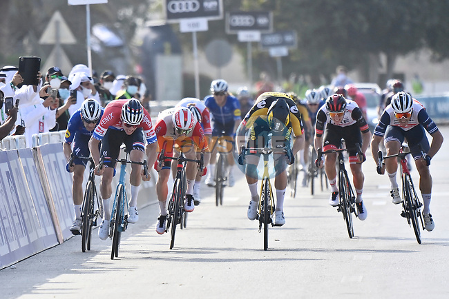 Mathieu van der Poel (NED) Alpecin-Fenix outsprints David Dekker (NED) Jumbo-Visma, Elia Viviani (ITA) Cofidis and Michael Mørkøv (DEN) Deceuninck-Quick Step to win Stage 1 of the 2021 UAE Tour the ADNOC Stage running 176km from Al Dhafra Castle to Al Mirfa, Abu Dhabi, UAE. 21st February 2021.  <br /> Picture: LaPresse/Fabio Ferrari | Cyclefile<br /> <br /> All photos usage must carry mandatory copyright credit (© Cyclefile | LaPresse/Fabio Ferrari)