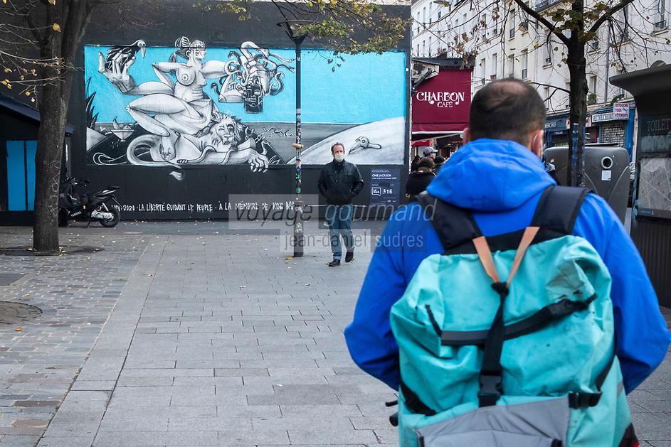 Europe/ Ile de France / Paris /75011 : Le mur d'Oberkampf, ce pari fou devenu une institution du street art parisien  sur l'immeuble de l'historique Café Charbon, L'association le M.U.R. (modulable, urbain, réactif) - Performance316: par l'artiste Onie Jackson. //  Europe / Ile de France / Paris / 75011: The Oberkampf wall, this crazy bet that has become an institution of Parisian street art on the building of the historic Café Charbon, the M.U.R. (modular, urban, responsive) - Performance 316 by artist Onie Jackson //