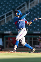 AZL Rangers third baseman Jonathan Ornelas (10) follows through on his swing during an Arizona League playoff game against the AZL Indians 1 at Goodyear Ballpark on August 28, 2018 in Goodyear, Arizona. The AZL Rangers defeated the AZL Indians 1 7-4. (Zachary Lucy/Four Seam Images)
