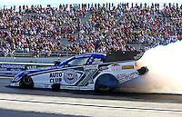 Aug. 17, 2013; Brainerd, MN, USA: NHRA funny car driver Robert Hight during qualifying for the Lucas Oil Nationals at Brainerd International Raceway. Mandatory Credit: Mark J. Rebilas-