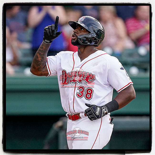 First baseman Tyreque Reed (38) of the Greenville Drive points skyward as he crosses the plate with a home run in a game against the Asheville Tourists on Tuesday, June 1, 2021, at Fluor Field at the West End in Greenville, South Carolina. (Tom Priddy/Four Seam Images) #MiLB #baseball