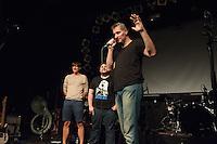 """Filmpremiere von """"Der Tag wird kommen"""".<br /> Anlaesslich der Premiere des Films """"Der Tag wird kommen"""" zum gleichnamigen Lied von Markus Wiebusch, spielte Wiebusch im Hamburger Club """"Knust"""" ein exklusives Konzert fuer die ca. 400 Unterstuetzer des Films. In dem Lied wird klar Stellung gegen Homophobie im Fussball bezogen. Ueber 1.000 Unterstuetzer mit in einer Crowdfounding-Kampagne die Finanzierung des Films gesichert. Fussballfans des FC. St. Pauli, Fortuna Duesseldorf, dem HSV, Bayern Muenchen und anderen Clubs haben diese Film durch ihre Mitwirkung unterstuetzt.<br /> Vlnr.: Stephfan Waak (Haupdarsteller), Dennis Dirksen (Regie-Team), Markus Wiebusch (Musik und Drehbuch).<br /> 6.9.2014, Hamburg<br /> Copyright: Christian-Ditsch.de<br /> [Inhaltsveraendernde Manipulation des Fotos nur nach ausdruecklicher Genehmigung des Fotografen. Vereinbarungen ueber Abtretung von Persoenlichkeitsrechten/Model Release der abgebildeten Person/Personen liegen nicht vor. NO MODEL RELEASE! Don't publish without copyright Christian-Ditsch.de, Veroeffentlichung nur mit Fotografennennung, sowie gegen Honorar, MwSt. und Beleg. Konto: I N G - D i B a, IBAN DE58500105175400192269, BIC INGDDEFFXXX, Kontakt: post@christian-ditsch.de<br /> Urhebervermerk wird gemaess Paragraph 13 UHG verlangt.]"""