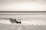Madison Town Beach. Bench in winter with snow. Long Island Sound.