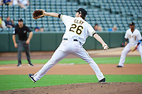 Caleb Clay (26) of the Salt Lake Bees delivers a pitch to the plate against the Tacoma Rainiers in Pacific Coast League action at Smith's Ballpark on July 9, 2014 in Salt Lake City, Utah.  (Stephen Smith/Four Seam Images)