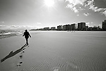 A woman walks on the beach in Perpignan, France. Feb. 14, 2009.