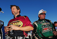 Oct. 30, 2011; Las Vegas, NV, USA: NHRA funny car driver John Force (right) talks with top fuel dragster driver Del Worsham before the Big O Tires Nationals at The Strip at Las Vegas Motor Speedway. Mandatory Credit: Mark J. Rebilas-