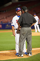 Buffalo Bisons manager Gary Allenson (5) argues a call with umpire Jansen Visconti during a game against the Norfolk Tides on July 18, 2016 at Coca-Cola Field in Buffalo, New York.  Norfolk defeated Buffalo 11-8.  (Mike Janes/Four Seam Images)