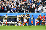 England players and staff celebrate Daniel Sturridge's late second half goal at the Stade Bollaert-Delelis in Lens, France this afternoon during their Euro 2016 Group B fixture against Wales.