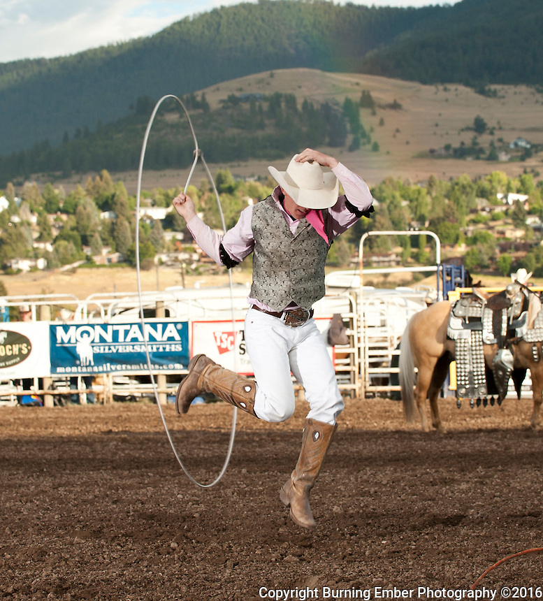 Rider Kiesner performs some trick roping at the Western Montana Fair PRCA Rodeo in Missoula MT August 12th 2016 2nd perf.  Josh Homer photo.  Photo credit must be given on all uses.  www.burningemberphotography.com