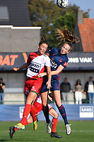 Charlotte Laridon (9) of Zulte Waregem and Sari Kees (2) of OH Leuven  pictured during a female soccer game between SV Zulte - Waregem and Oud Heverlee Leuven on the sixth matchday of the 2021 - 2022 season of Belgian Scooore Womens Super League , saturday 9 of October 2021  in Zulte , Belgium . PHOTO SPORTPIX | DIRK VUYLSTEKE
