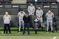 Swansea City manager Steve Cooper and his staff observe a minute's silence before kick off during the Sky Bet Championship match between Swansea City and Cardiff City at the Liberty Stadium, Swansea, Wales, UK. Saturday 20 March 2021