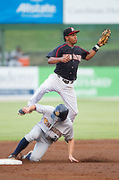 Kannapolis Intimidators shortstop Cleuluis Rondon (5) catches a high throw as John Murphy (3) of the Charleston RiverDogs steals second base at CMC-NorthEast Stadium on June 27, 2014 in Kannapolis, North Carolina.  The Intimidators defeated the RiverDogs 6-5.  (Brian Westerholt/Four Seam Images)