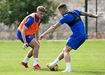 St Johnstone Training...  McDiarmid Park<br />Reece Devine watches Callum Hendry closely during training ahead of Saturday's opening league game of the season at Ross County.<br />Picture by Graeme Hart.<br />Copyright Perthshire Picture Agency<br />Tel: 01738 623350  Mobile: 07990 594431