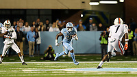 CHAPEL HILL, NC - NOVEMBER 02: Javonte Williams #25 of the University of North Carolina runs the ball during a game between University of Virginia and University of North Carolina at Kenan Memorial Stadium on November 02, 2019 in Chapel Hill, North Carolina.