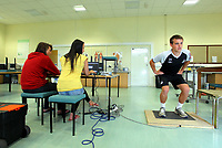Pictured: Scott Donnelly (R) gets tested by students of the Sports Science department.<br /> Re: Swansea City FC footballers take fitness test at Swansea University Sports Science department<br /> Picture by D Legakis Photography/Athena Picture Agency, Swansea, 07815441513