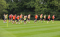Pictured: Players warming up. Thursday 14 August 2014<br /> Re: Swansea City FC training at Fairwood, south Wales, ahead of their first game of the Premier League season against Manchester United this coming Saturday.