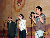 July,26, 2000 Montreal, Quebec, Canada<br /> HK actor Lau Ching-Wan (right) and his wife answer questions from fans after the projection of Ringo Lam latest movie :  ``Victim``.<br /> The movie in which he plays the lead caracter was presented on July 26, 2000 at the Fantasia Film Festival in Montreal, Canada, a few days after Johnny To's  ``Running Out Of Time``  , another movie in which he has a major role.<br /> <br /> Photo by Pierre Roussel - Images Distribution