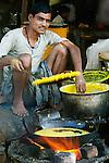 Man cooking at market, Bundi, India