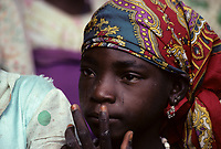 Matameye, Niger, West Africa.  Young Hausa Girl in Multicolored Headscarf.