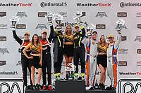 #28 RS1, Porsche Cayman GT4 MR, GS: Dillon Machavern, Spencer Pumpelly, #7 VOLT Racing, Ford Mustang GT4, GS: Alan Brynjolfsson, Trent Hindman, podium