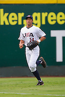 Left fielder George Springer #14 of Team USA chases after a fly ball against Team Korea at Knights Stadium July 16, 2010, in Fort Mill, South Carolina.  Photo by Brian Westerholt / Four Seam Images