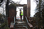 BELLE HARBOR, NEW YORK-NOVEMBER 01: A home destroyed by fire during Hurricane Sandy is surveyed November 1, 2012 in this Queens neighborhood devastated by the storm. A large number of homes and businesses were destroyed and much of the area is without power.