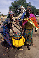Akadaney, Niger. Fulani Women Carrying Water from Well to Livestock.
