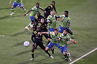 COLUMBUS, OH - DECEMBER 12: Gyasi Zardes #11 of the Columbus Crew and Shane O'Neill #27 and Cristian Roldan #7 of the Seattle Sounders FC wait for a corner kick during a game between Seattle Sounders FC and Columbus Crew at MAPFRE Stadium on December 12, 2020 in Columbus, Ohio.