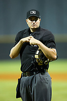 Home plate umpire Ben Fernandez during the Appalachian League game between the Danville Braves and the Burlington Royals at Burlington Athletic Stadium on August 15, 2017 in Burlington, North Carolina.  The Royals defeated the Braves 6-2.  (Brian Westerholt/Four Seam Images)