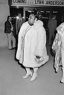 Manhattan, New York City, NY - January 28, 1974<br /> Muhammad Ali and Joe Frazier at Madison Square Garden.<br /> Billed as the 'Fight of the Century' African-American boxing fans and dandies attended wearing the most glam-fashions of the day. Furs, minis and thigh-high platform boots were all the rage.