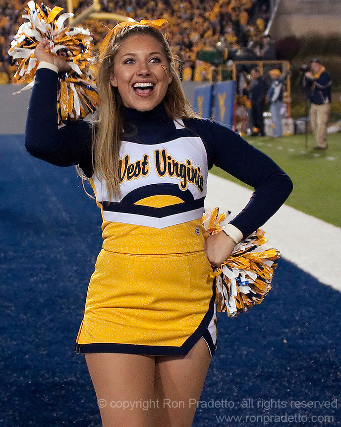 WVU cheerleader. The West Virginia Mountaineers defeated the South Florida Bulls 20-6 on October 14, 2010 at Mountaineer Field, Morgantown, West Virginia.
