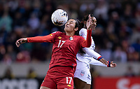 HOUSTON, TX - JANUARY 31: Gabriela Villagrand #17 of Panama goes up for a header with Crystal Dunn #19 of the United States during a game between Panama and USWNT at BBVA Stadium on January 31, 2020 in Houston, Texas.