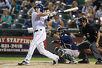 Round Rock Express shortstop Brendan Harris (6) follows through on his swing against the Oklahoma City RedHawks during the Pacific Coast League baseball game on August 25, 2013 at the Dell Diamond in Round Rock, Texas. Round Rock defeated Oklahoma City 9-2. (Andrew Woolley/Four Seam Images)