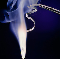 MAGNESIUM BURNING IN AIR: AN EXOTHERMIC REACTION<br /> Producing White Flame & Smoke Of Magnesium Oxide<br /> Magnesium, a group IIA alkaline earth metal burns in air with a bright white flame, producing a white smoke of solid magnesium oxide. What remains after burning is solid magnesium oxide.