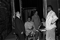 """. February 23, 1967. Shot of scene, backstage view, from left to right, Mr. Louis Izar (Director General of the Capitole Theater), seated on a stool legs singer Olive Moorefield, standing behind Singer Elaine Baker, sitting a plastic doll on the knees the singer Miriam Burton and standing singer William Rey. Observation: Repetition, at the Capitole Theater of the American opera """"Porgy and Bess"""", Music by geoge Gershwin, on the occasion of the 30th anniversary of his death."""