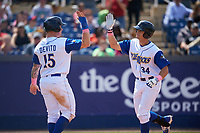 Wilmington Blue Rocks Chris Devito (15) high fives Roman Collins (34) after hitting a home run during the first game of a doubleheader against the Frederick Keys on May 14, 2017 at Daniel S. Frawley Stadium in Wilmington, Delaware.  Wilmington defeated Frederick 10-2.  (Mike Janes/Four Seam Images)