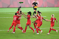 YOKOHAMA, JAPAN - AUGUST 6: Julia Grosso #7 of Canada celebrates making the winning PK with tammates during a game between Canada and Sweden at International Stadium Yokohama on August 6, 2021 in Yokohama, Japan.