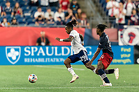 FOXBOROUGH, MA - AUGUST 18: Yordy Reyna #29 of D.C. United dribbles as DeJuan Jones #24 of New England Revolution defends during a game between D.C. United and New England Revolution at Gillette Stadium on August 18, 2021 in Foxborough, Massachusetts.