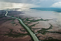 Aerial of green river of a recnet rain through the mud flats just outside town of Wyndham.