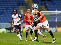 Bolton Wanderers' Nathan Delfouneso competing with Salford City's Tom Clarke (right) <br /> <br /> Photographer Andrew Kearns/CameraSport<br /> <br /> The EFL Sky Bet League Two - Bolton Wanderers v Salford City - Friday 13th November 2020 - University of Bolton Stadium - Bolton<br /> <br /> World Copyright © 2020 CameraSport. All rights reserved. 43 Linden Ave. Countesthorpe. Leicester. England. LE8 5PG - Tel: +44 (0) 116 277 4147 - admin@camerasport.com - www.camerasport.com
