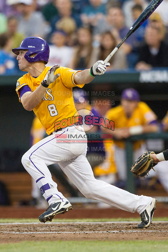 LSU Tigers shortstop Alex Bregman (8) follows through on his swing against the TCU Horned Frogs in Game 10 of the NCAA College World Series on June 18, 2015 at TD Ameritrade Park in Omaha, Nebraska. TCU defeated the Tigers 8-4, eliminating LSU from the tournament. (Andrew Woolley/Four Seam Images)
