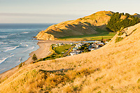 Morning light on Kairakau Beach settlement, Hawke's Bay, East Coast, North Island, New Zealand, NZ