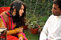 A guest has his fortune told by a fortune teller at a party before the wedding of British/Punjabi couple Lindsay and Navneet Singh.