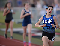 Mia Loafman of Rogers (right) pulls away from the lead pack Friday, April 30, 2021, in the final lap of the 3,200 meters during the 6A-West Conference Track and Field Meet at the Tiger Athletic Complex in Bentonville. Visit nwaonline.com/210501Daily/ for today's photo gallery. <br /> (NWA Democrat-Gazette/Andy Shupe)