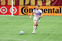 ATLANTA, GA - AUGUST 29: Oriol Rosell #20 of Orlando City dribbles the ball during a game between Orlando City SC and Atlanta United FC at Marecedes-Benz Stadium on August 29, 2020 in Atlanta, Georgia.