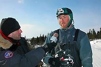 Zack Steer talks to KNOM reporter Paul Korchin at Koyuk. Photo by Jon Little.