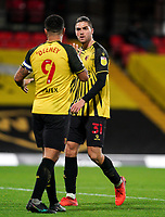 Francisco Sierralta of Watford chats to Troy Deeney of Watford during the Sky Bet Championship behind closed doors match played without supporters with the town in tier 4 of the government covid-19 restrictions, between Watford and Norwich City at Vicarage Road, Watford, England on 26 December 2020. Photo by Andy Rowland.