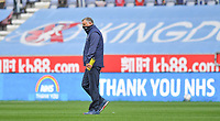 Blackburn Rovers' Manager Tony Mowbray crosses the pitch as the advertising boards thank the NHS<br /> <br /> Photographer Dave Howarth/CameraSport<br /> <br /> The EFL Sky Bet Championship - Wigan Athletic v Blackburn Rovers - Saturday 27th June 2020 - DW Stadium - Wigan<br /> <br /> World Copyright © 2020 CameraSport. All rights reserved. 43 Linden Ave. Countesthorpe. Leicester. England. LE8 5PG - Tel: +44 (0) 116 277 4147 - admin@camerasport.com - www.camerasport.com