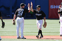 May 24th 2009:  Outfielder Joe Inglett (1) of the Toronto Blue Jays high fives Jesse Litsch (51) after a complete game at the Rogers Centre in Toronto, Ontario, Canada .  Photo by:  Mike Janes/Four Seam Images