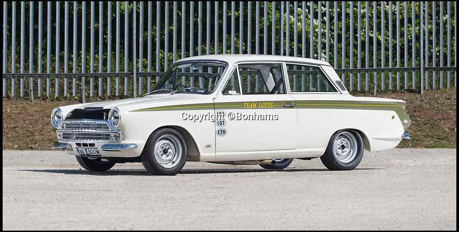 BNPS.co.uk (01202 558833)Pic: Bonhams/BNPS<br /> <br /> 53 year old Ford Cortina? - Yours for £250,000!<br /> <br /> A classic Ford Cortina that was raced by legendary Formula 1 racing driver Jim Clark, has emerged for sale for a record-breaking price of £250,000.<br /> <br /> The sporty two-door classic was twice used by the iconic driver in the 1965 British Saloon Car Championships and was also raced by some of the finest domestic drivers of the time.<br /> <br /> It was campaigned by Team Lotus, who helped to develop the racing version of the Cortina alongside Ford, and it was for them that Clark got behind the wheel.<br /> <br /> It is thought the two-time F1 world champion was impressed by the performance of the Ford-Lotus, which he raced at both Silverstone and Brands Hatch.<br /> <br /> The car was sold eventually by Lotus in 1967 and went on to fall into a state of disrepair before it was salvaged and restored in the early 2000s. <br /> <br /> It has now emerged for sale with Bonhams Auctions who have given it a pre-sale estimate of between £200,000 and £250,000.